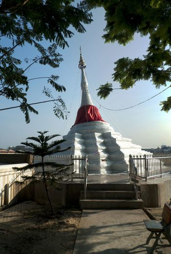 The Leaning Chedi, at Ko Kret, just north of Bangkok. Or was it just too much Mekong Whisky the night before? Ko Kret Worship Architecture Belief Buddhism Building Exterior Built Structure Chedi Day Flag Nature No People Outdoors Religion Sky Tree
