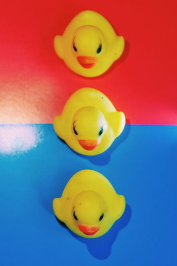 Close-up of yellow toy floating on blue background
