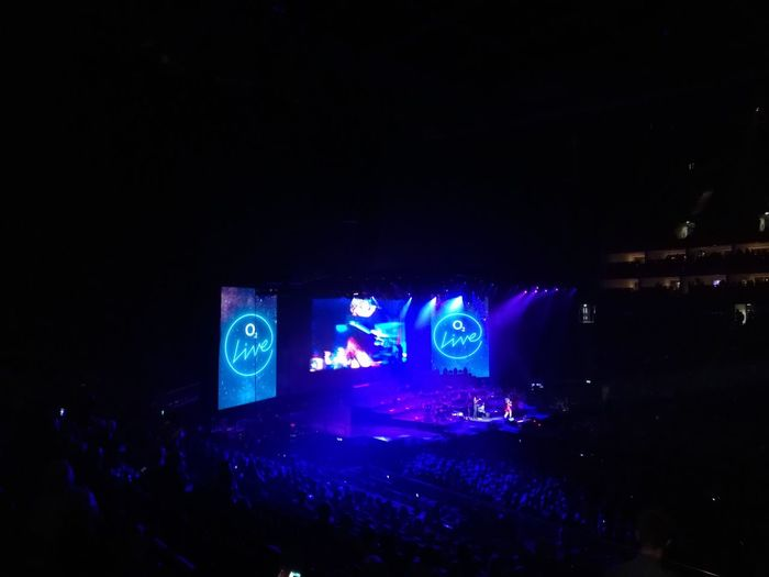 London O2 Arena Arts Culture And Entertainment Blue Copy Space Dark Enjoyment Group Of People Illuminated Indoors  Large Group Of People Light - Natural Phenomenon Music Night Nightclub Nightlife Performance Real People Stage Stage - Performance Space Technology