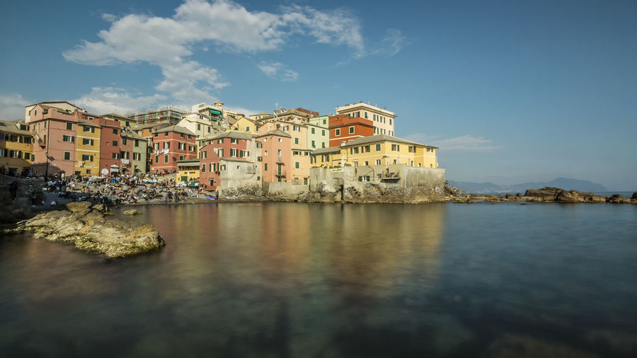 Typical fishing village with colored houses and crowded beach in the city of genoa