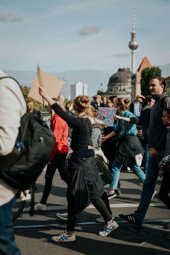 Group of people walking in front of buildings