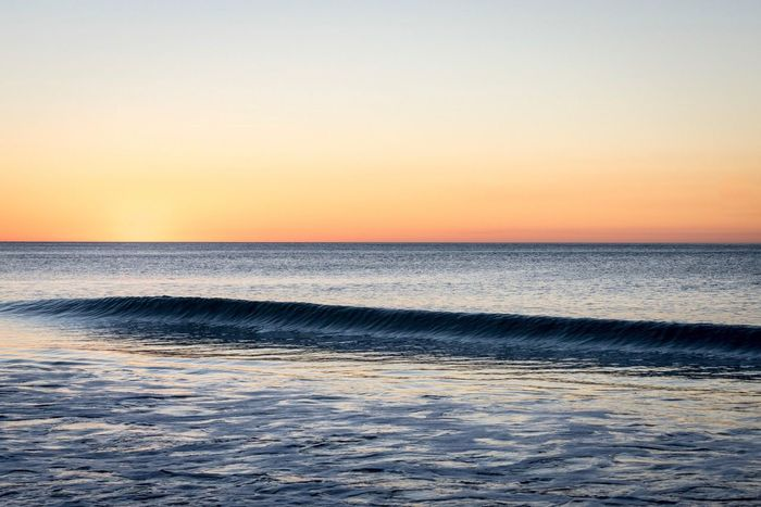 Sky Sea Sunset Scenics Beauty In Nature Horizon Over Water Nature Tranquil Scene Water Tranquility Beach Idyllic No People Clear Sky Outdoors Sand Wave Vacations Day