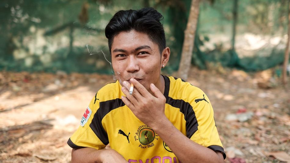 Chin player resting after the game in a suburb of Yangon Myanmar Myanmar Yangon Travel People EyeEm Selects One Person Real People Lifestyles Front View Leisure Activity Portrait Focus On Foreground