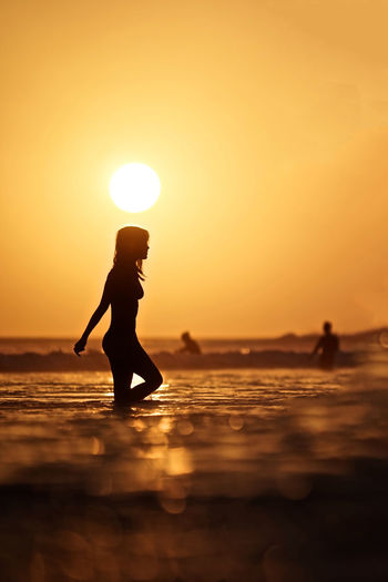 Bali Sunset Silhouettes Sunset_collection Adult Beach Beauty In Nature Bikini Horizon Over Water Idyllic Land Leisure Activity Lifestyles Nature Orange Color Outdoors Real People Scenics - Nature Sea Silhouette Sky Standing Sun Sunlight Sunset Water