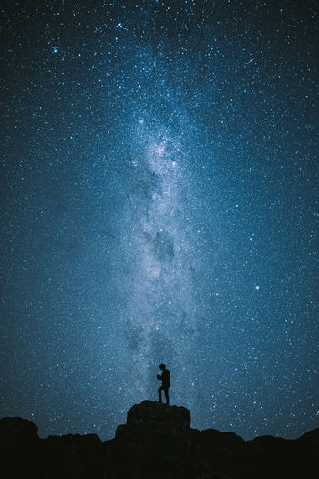 Adventure Alone Astronomy Astrophotography Galaxy Landscape Milky Way Nature Night One Person Outdoors Rock - Object Silhouette Sky Space Star - Space Stars EyeEmNewHere Breathing Space Lost In The Landscape The Great Outdoors - 2018 EyeEm Awards The Traveler - 2018 EyeEm Awards