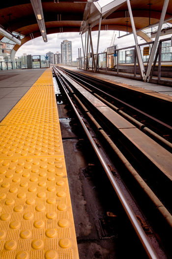 Rail Transportation Track Railroad Track Railroad Station Platform Railroad Station Transportation Public Transportation Architecture No People Mode Of Transportation Yellow Metal Built Structure Diminishing Perspective Train Travel Day Absence Outdoors Station Platform Long