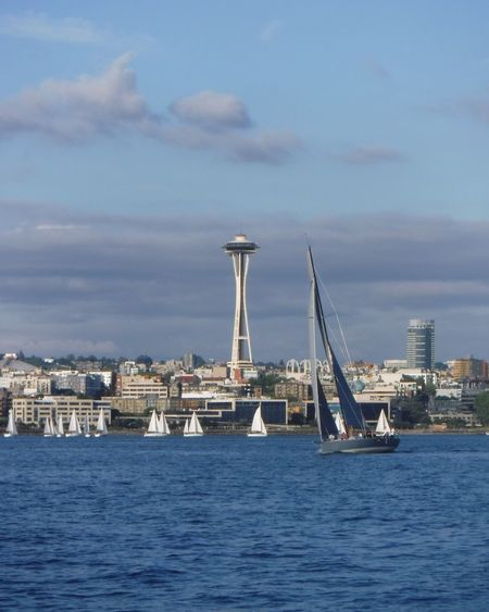 Sailboat on Elliot Bay and Space Needle movement harbor area Snapshots of Life Movement Harbor Area Ferry Views Travel Seattle Skyline Weekend Activities Sailing Skyline Luxury Iconic Buildings Bustling City Liesure Activity Sport Regatta Seaport Pacific Northwest  Liesure Activity Harbor Area Saiboat Summer Travel Small Sail Boat Breeze Summer Fun Architecture City Urban Skyline Sailboat