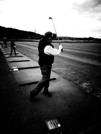 Rydercup Celticmanor Concentration. Full Length Men Sport Standing Golf Swing Motion Sky