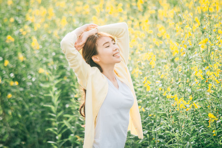 Adult Arms Raised Beautiful Woman Beauty Beauty In Nature Eyes Closed  Field Flower Flowering Plant Hair Hairstyle Happiness Human Arm Nature One Person Outdoors Plant Smiling Springtime Standing Waist Up Women Yellow Young Adult Young Women