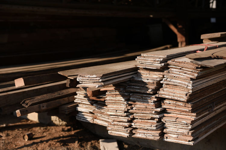 Stack of old books on railroad track