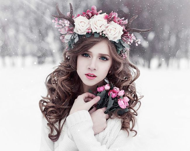 Woman Holding Flowers In Snow