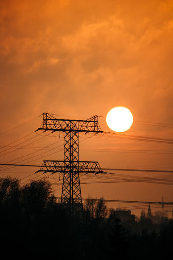 Sky Sunset Silhouette Orange Color Cloud - Sky Sun Technology Electricity Pylon Nature Electricity  Low Angle View Connection Plant Cable Beauty In Nature No People Power Line  Tree Outdoors Scenics - Nature Power Supply