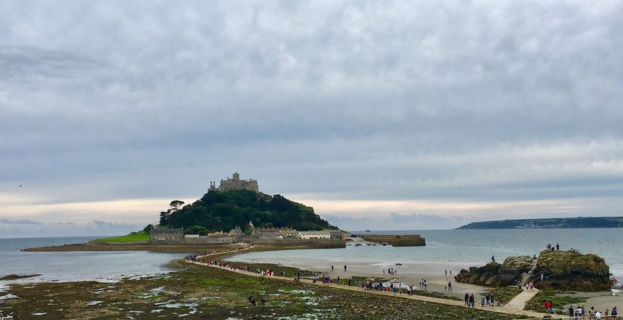 St. Michael's Mount Sea Water Sky Cloud - Sky Built Structure Nature Architecture Scenics Horizon Over Water Day Beauty In Nature Outdoors Beach Tranquility Building Exterior Travel Destinations Large Group Of People Real People Grass People