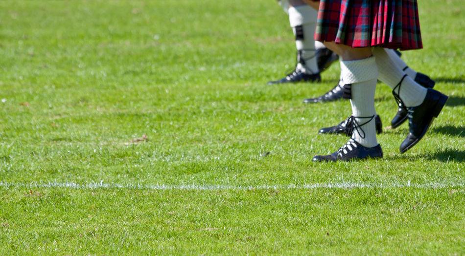 Low section of schoolgirls on soccer field