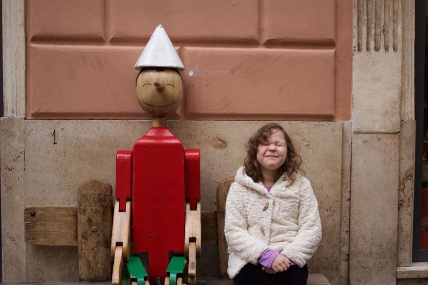 pinocchio and a girl on Roma Adult Architecture Arms Crossed Blond Hair Building Exterior Built Structure Child Childhood Children Only Day Friendship Girls Medium-length Hair One Girl Only One Person Only Girls Outdoors People Pinocchio Portrait Red Smiling Standing An Eye For Travel Moving Around Rome Stories From The City Adventures In The City It's About The Journey