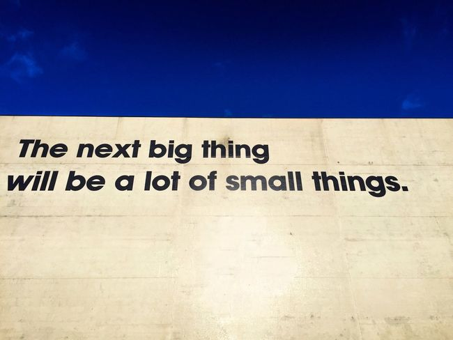 The next big thing will be a lot of small things Minimalism Minimalist Minimal Wall Writing On The Walls Things Quote Two Colours Sentence Half And Half Blue White Bigthings Small Things