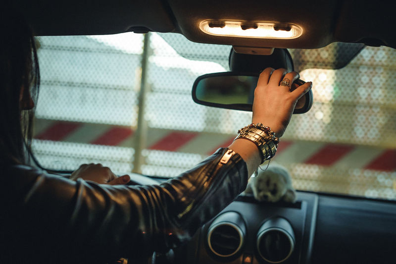 Car Car Interior Day Driving Hand Human Body Part Indoors  Land Vehicle Leisure Activity Lifestyles Men Mode Of Transportation Motor Vehicle One Person Real People Road Trip Transportation Travel Vehicle Interior Women