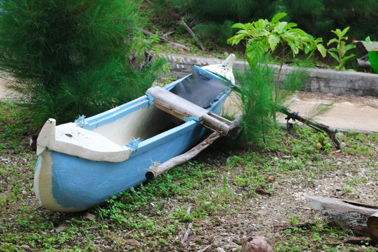 Lone vaka Cook islands Atiu Blue Canoe Cook Islands Lasting Lone No People Old Outdoors Strong Times Past Vaka
