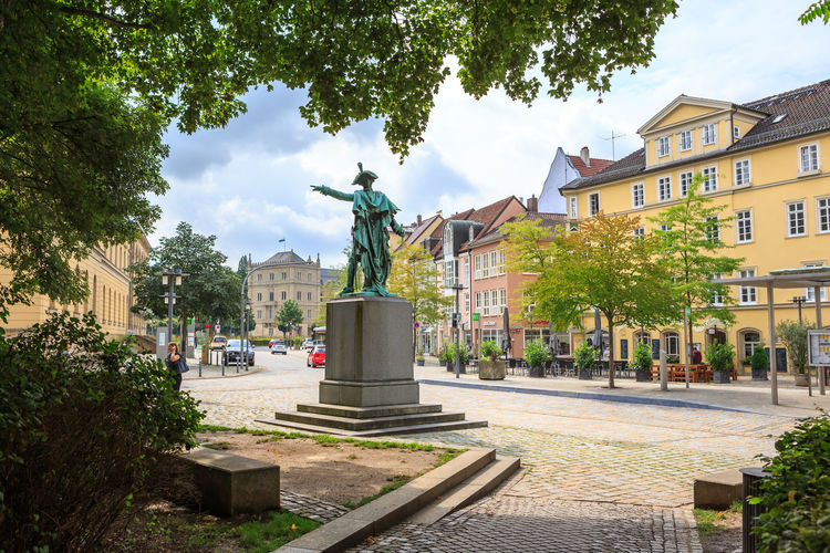 COBURG, GERMANY - CIRCA AUGUST, 2016: Townscape of Coburg in Bavaria, Germany Architecture, Castle, Coburg, Editorial, Europe, European, Garden, Germany, Historic, Landmark, Old, Outdoors, Palace, Park, Plants, Stone, Street, Traditional, Travel, Urban Architecture Tree Statue Sculpture Building Exterior Built Structure Plant Human Representation Representation Art And Craft Male Likeness Nature City Day Sky Incidental People Creativity Building Memorial Cloud - Sky Outdoors