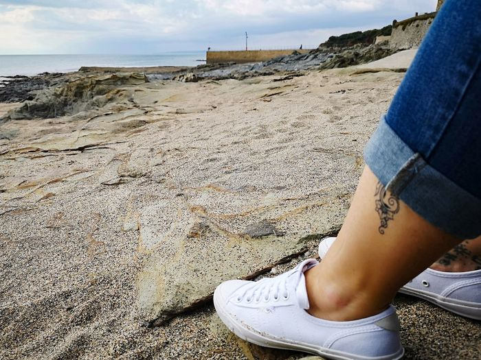enjoying the calm and autumn sun Sexy Ankle Rolled Up Jeans And White Pumps Cornwall Nature Popular Photos Coastal Life Coastal_collection Autumn 2018 A Quiet Moment A Quiet Day At The Beach.... Tattoo Mehndi Low Section Beach Sand Sky Close-up Human Leg Footwear Flat Shoe Personal Perspective Shore Shoelace Canvas Shoe Coast This Is Natural Beauty