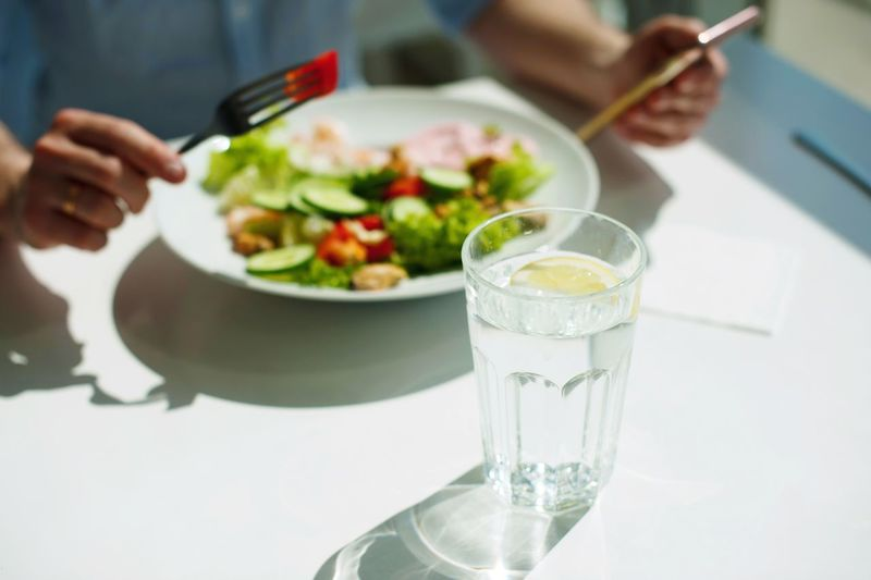 young guy eating a salad Food And Drink Glass Freshness Healthy Eating Food Table Refreshment Focus On Foreground Ready-to-eat Vegetable Wellbeing Human Hand Meal Holding Salad Drinking Glass Indoors  Household Equipment Drink Fruit