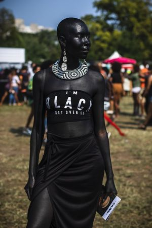 D.S.E.Detroit at AfroPunk Brooklyn 2018 Focus On Foreground Incidental People Day Real People Text Outdoors Rear View Focus On Foreground Incidental People Day Real People Text Outdoors Rear View People Nature Communication Field Close-up Standing Western Script Clothing Human Representation Plant Black Color Park