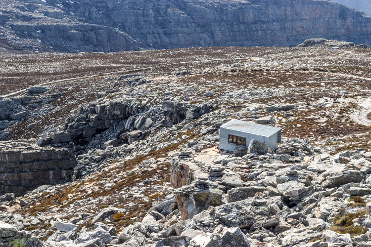 Secluded mountain hut on rocky outcrop Cabin Explore Hike Hiking House Hut Landscape Landscape_Collection Metal Mountain Nature No People Outdoor Photography Outdoors Refuge Rock - Object Rugged Shed Simple View