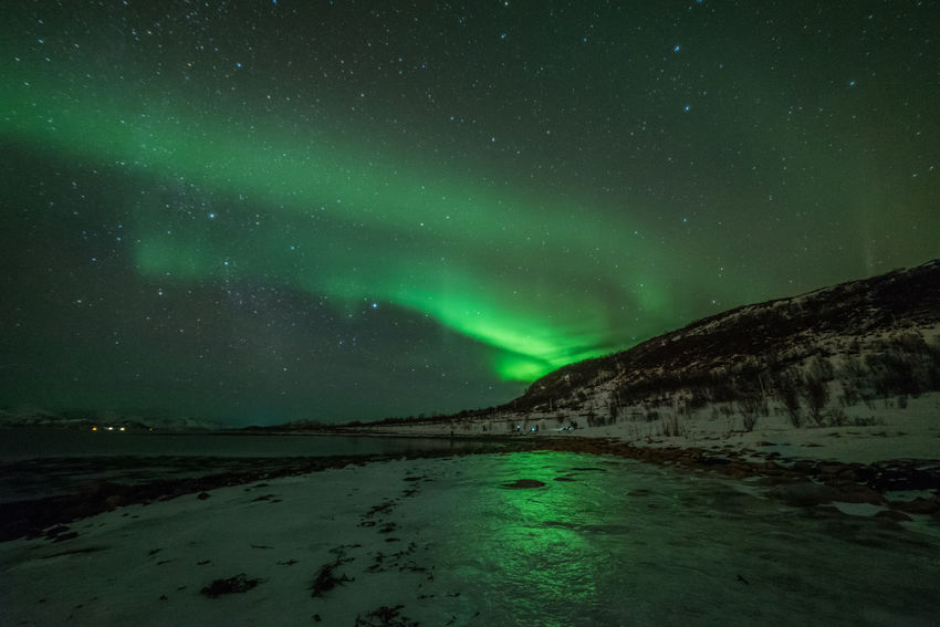 Northern lights with a beautiful reflection in the ice Aurora Borealis Ice Northern Lights Reflection Astronomy Aurora Polaris Beauty In Nature Cold Temperature Galaxy Green Color Lake Landscape Mountain Nature Night No People Scenics Sky Snow Space Star - Space Tranquil Scene Tranquility Water Winter