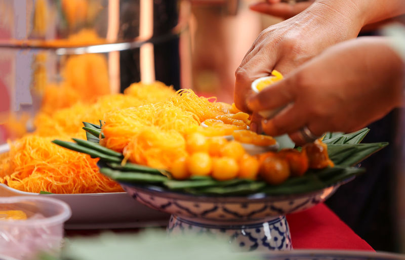 Thailand Business Close-up Finger Food Food And Drink Freshness Hand Healthy Eating Holding Human Body Part Human Hand Indoors  One Person Preparation  Preparing Food Real People Selective Focus Unrecognizable Person Vegetable Wellbeing