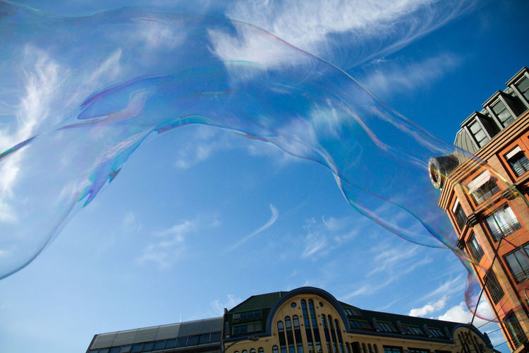 Low Angle View Of Bubbles And Buildings Against Sky