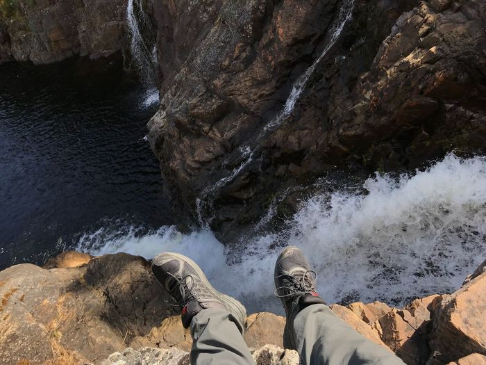 By the waterfall 2 Waterfall Outdoor Life Adventure Hiking Low Section Human Leg Water Real People Nature Human Body Part Beach Personal Perspective Rock Leisure Activity High Angle View Outdoors