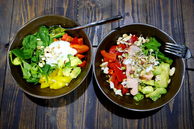 Food Bowls with healthy food. Freshness Vegetarian Vegetarian Food Bowl Bowls Close-up Day Food Food And Drink Food Bowl Fork Freshness Healthy Eating High Angle View Indoors  No People Ready-to-eat Salad Salad Bowl Vegan Vegan Food Vegetable Vegetables Wood - Material