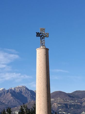 Metal Art Rood Mountain Sky Blue Agriculture Day Statue Outdoors Travel Destinations Sculpture Architectural Column Mountain Range Snow Nature Clear Sky Architecture No People