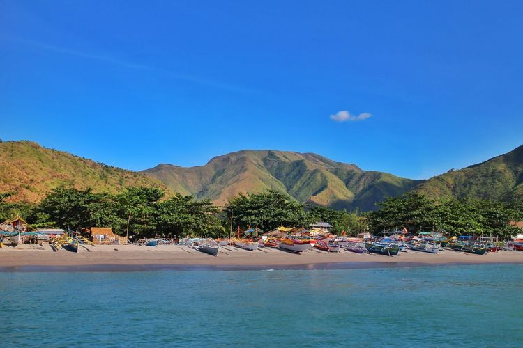 of land and sea Water Blue Beach Nature Sea Sky Outdoors Mountain Tranquility Scenics No People Beauty In Nature Day Boats Boat Shore Shoreline San Antonio Zambales Philippines