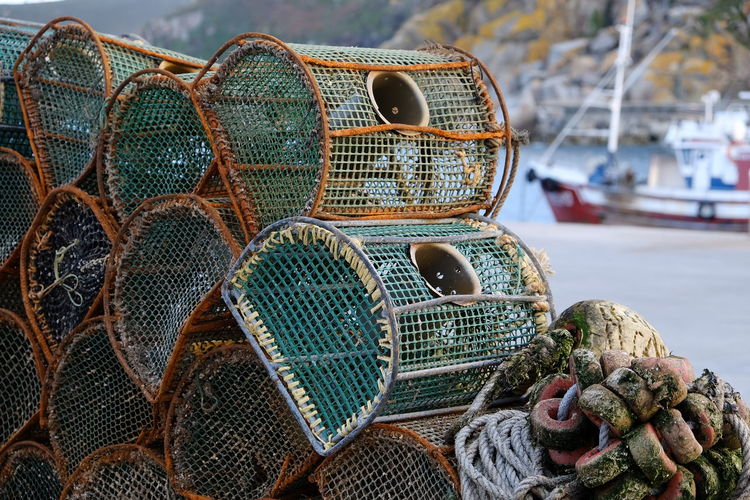 Close-up of lobster traps at harbor