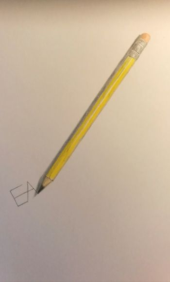 Close-up of yellow pencils on white background