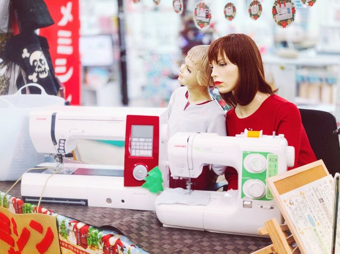 Mannequins and sewing machines at store