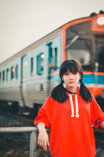 Portrait Of Girl Standing Against Train