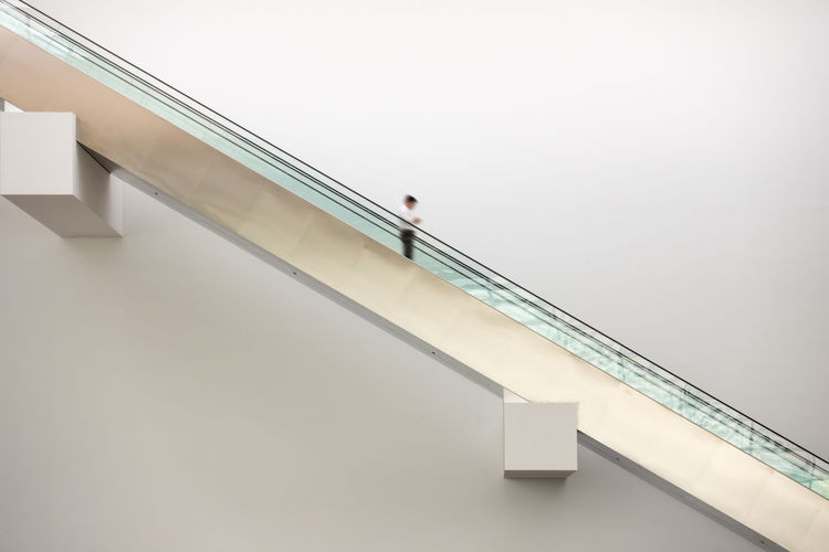 Low angle view of man standing on staircase against building