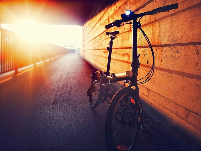 Bicycle on street in city during sunset
