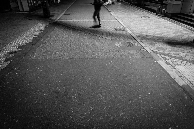 Nightlife Japan Tokyo Shibuyascapes Midnight Simplicity Dji Osmo Pocket DJI OSMO POCKET Minimal Minimalism Light And Shadow Silhouette Black And White Monochrome Street Real People City Low Section Street Walking Transportation Day One Person Lifestyles Footpath High Angle View Unrecognizable Person Human Leg Nature 17.62° My Best Photo