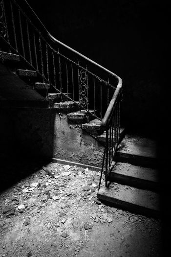 Abandoned staircase against old building