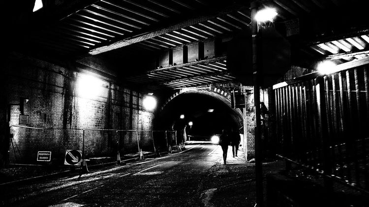urban chaos Photowalktheworld EyeEm Selects Blackandwhite person Surreal Black And White Manipulation Sillouette Town Urbanphotography Streetphotography Full Length Architecture Tunnel Light At The End Of The Tunnel Underground Underground Walkway Fluorescent Light Light Fixture Architectural Design Recessed Light Arch Underpass