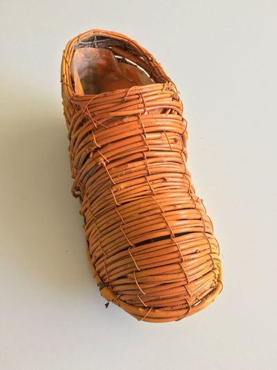 Orange shoe Orange Shoes EyeEm Selects Brown Studio Shot No People Indoors  Single Object Close-up Still Life Old Wicker Textured  White Background Nature Pattern Wall - Building Feature Art And Craft Creativity Day Food History