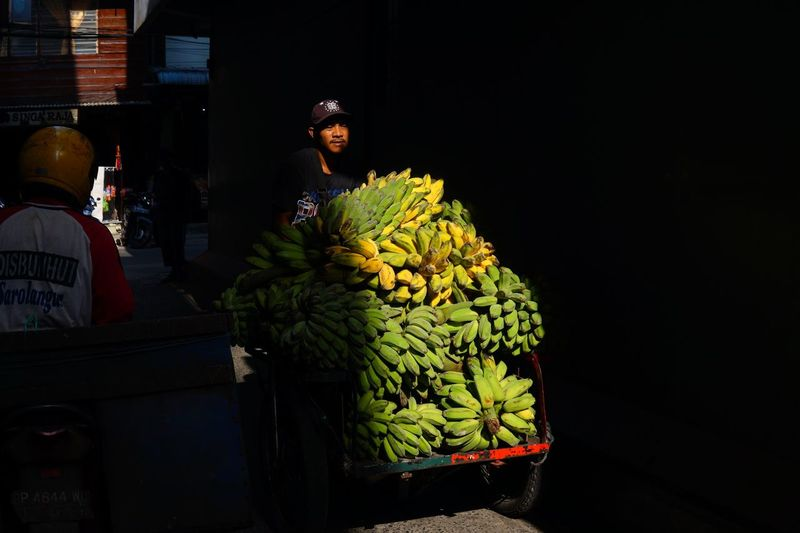 Goods trishaw spotted at Tanjung Pinang, Riau Island, Indonesia Tanjung Pinang Riau Island Banana Trishaw For Sale Night Vegetable Food Market Freshness Mobility In Mega Cities Healthy Eating Outdoors One Person People HUAWEI Photo Award: After Dark