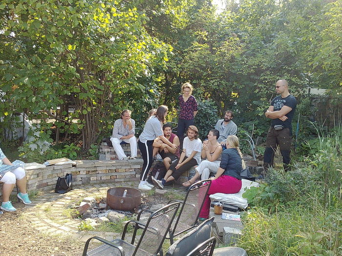 Group of people sitting by plants