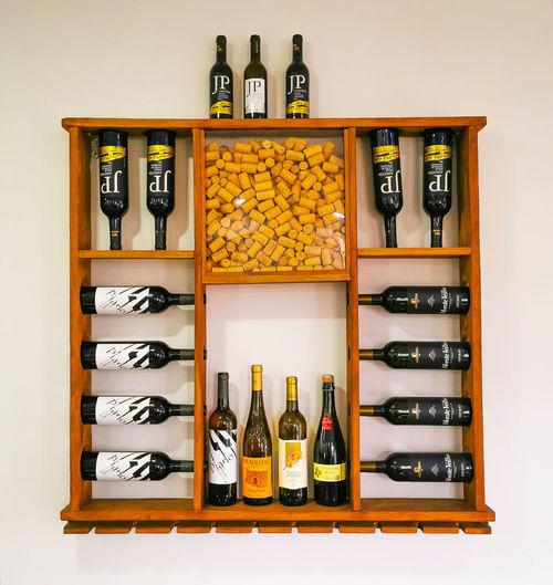 Various bottles on shelf against white background