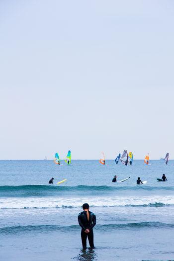 To surf or not to surf? Beach Clear Sky Horizon Over Water Kamakura Beach Kamakura Sea Kamakura Surfers Surf Surf In Japan Surf In Kamakura Surf Photography Surfer Surfing Thinking