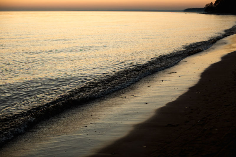 Water Beach Sea Nature Sand Land Sky Sunset Scenics - Nature Beauty In Nature No People Sunlight Tranquility Day Shadow Motion Outdoors Tranquil Scene Sport Horizon Over Water