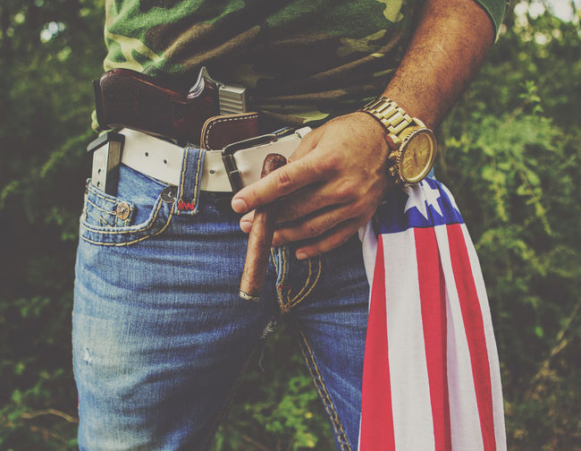 Gun Texas Adult America Casual Clothing Close-up Day Flag Focus On Foreground Hand Holding Human Body Part Human Hand Jeans Men Midsection Murica Nature One Person Outdoors Patriotism Real People Sig Sauer Standing Striped